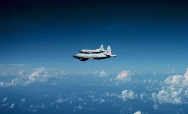 Both NOAA P-3's flying to a mission. Picture