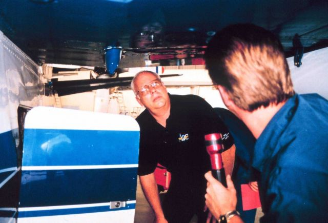 Greg Bast and Mike Merek performing maintenance on Twin Otter Picture