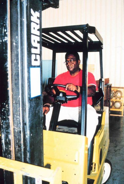 Zeke Brown operating the forklift in hangar Picture