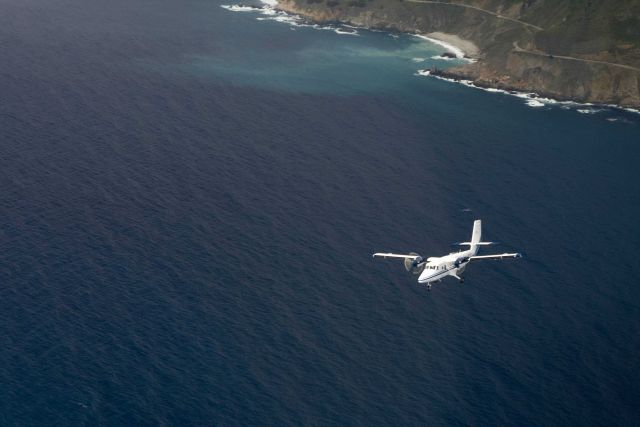 NOAA Twin Otter aircraft conducting marine mammal surveys off the Big Sur coastline. Picture