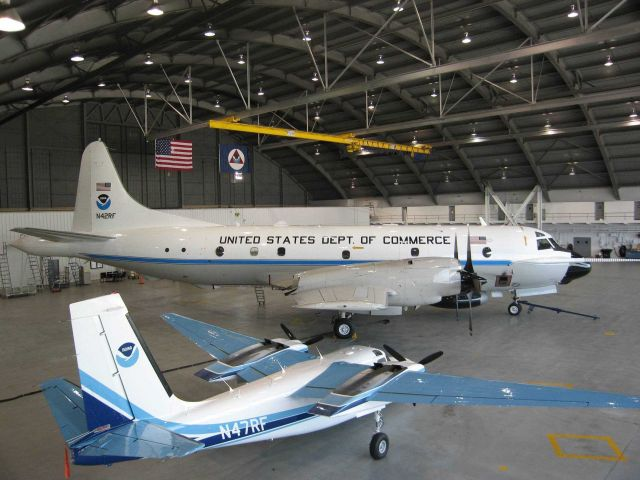 NOAA P-3 N42RF hurricane hunter and NOAA Rockwell Aero Commander AN47RF remote sensing mission aircraft in hangar at MacDill AFB. Picture