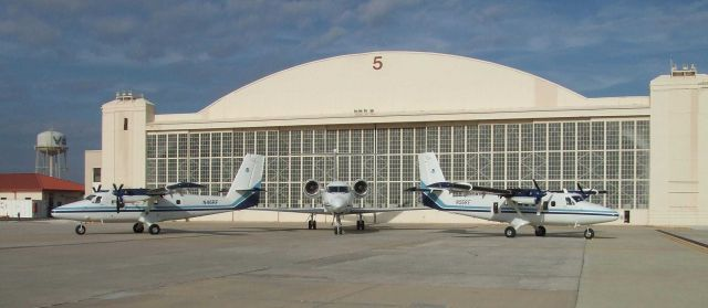 NOAA Twin Otter aircraft N46RF and N56RF flank NOAA Gulf Stream IV N49RF. Picture