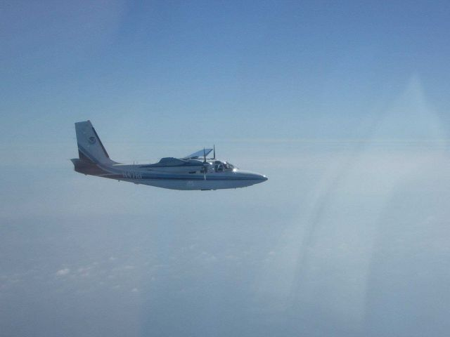 Rockwell Aero Commander (AC-500S) N47RFin flight starboard side. Picture