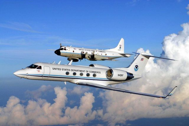 NOAA Gulf Stream IV N49RF and NOAA P-3 N43RF in flight. Picture