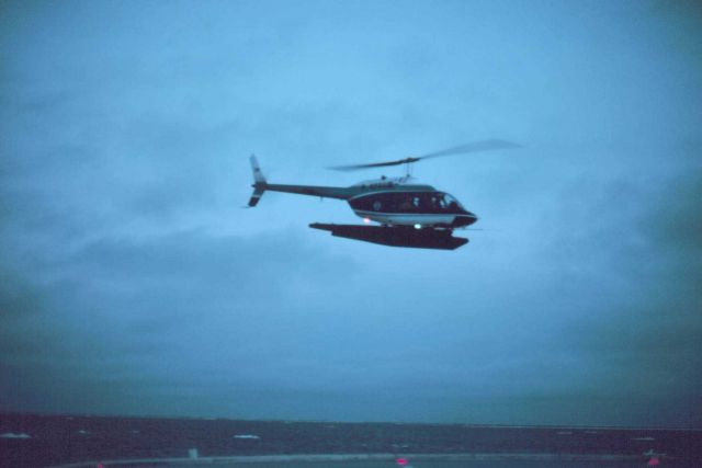 Lieutenant Budd Christman flying leased Bell 206 in Bering Sea. Picture