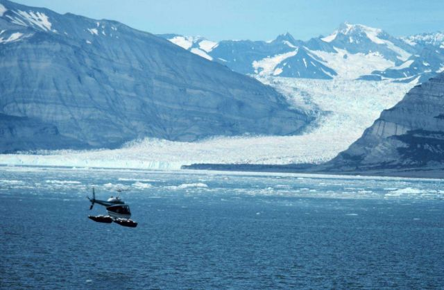 Lieutenant Bill Harrigan flying Bell 206 during Icy Bay current studies. Picture