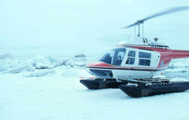 Leased Bell 206 set down on ice for seal tagging Picture