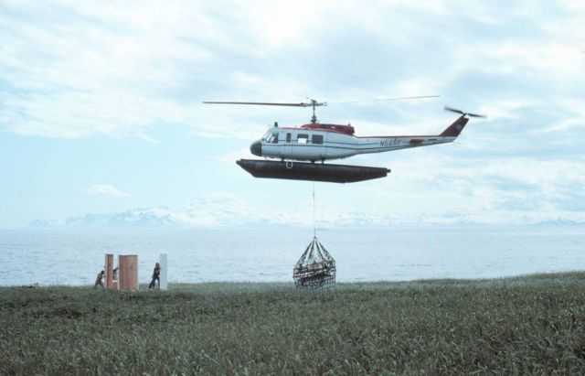 Bell UH-1H N56RF at Cape Douglas sling-loading camp equipment for shore camp. Picture