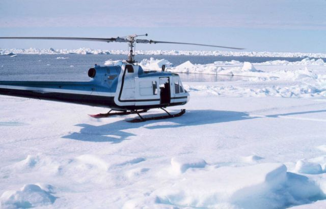 Bell UH-1M supporting OCSEAP scientific studies north of Prudhoe Bay. Picture