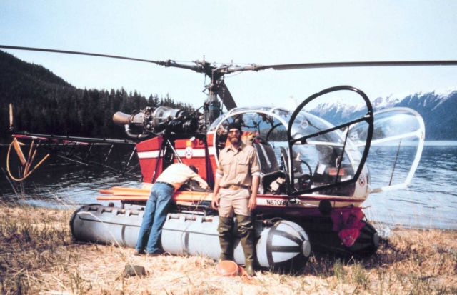 Contract helicopter transporting NOAA geodetic surveyors in southeast Alaska. Picture