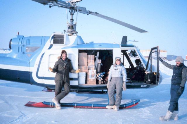 Brendan Kelley and Lori Quackenbush of the University of Alaska Fairbanks and NOAA helicopter mechanic Russ Talley (on right) loading Bell UH-1M with  Picture