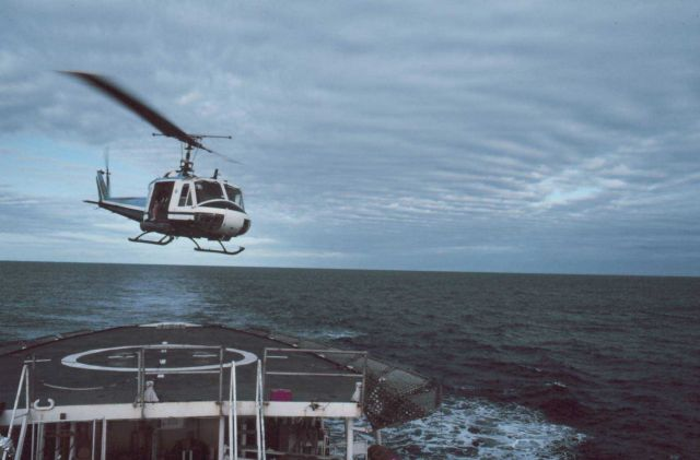 NOAA Bell UH-1M operating off NOAA Ship SURVEYOR helicopter platform. Picture
