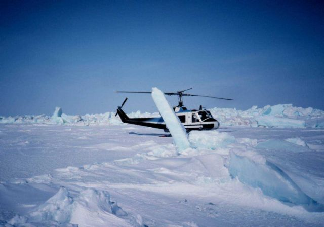 Bell UH-1M on the ice of the Beaufort Sea conducting seal research. Picture