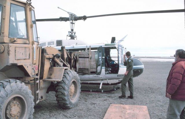 Loading Bell UH-1M helicopter with camp gear for bird studies in the Prudhoe Bay area. Picture