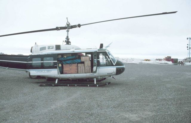 Loaded Bell UH-1M helicopter with camp gear for bird studies in the Prudhoe Bay area. Picture