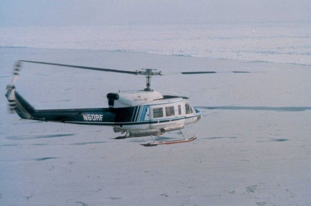 NOAA Bell 212 flying over North Slope of Alaska approaching the ice of the Beaufort Sea. Picture