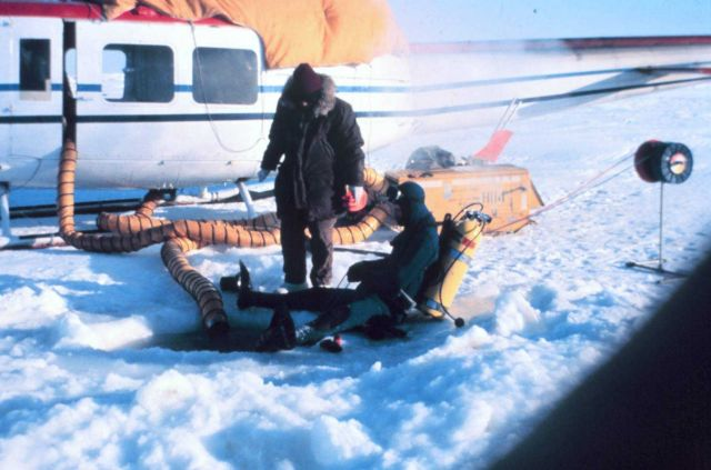 Helicopter supporting under-ice dive operations in the Beaufort Sea. Picture