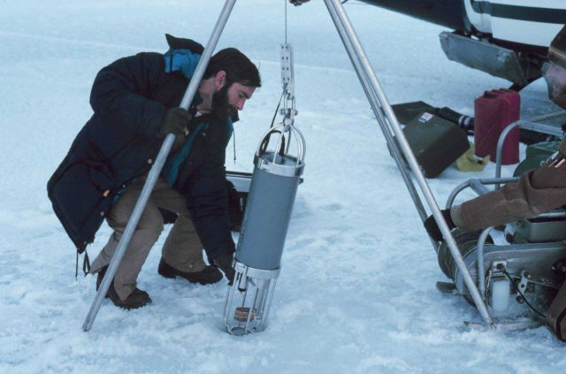 Helicopter pilot Bud Christman helping with science operations in the Beaufort Sea area. Picture