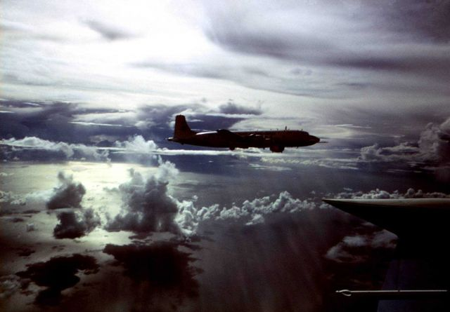 ESSA DC-6 hurricane research aircraft over the tropical Atlantic in late afternoon sun. Picture