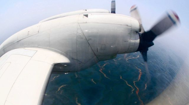 The Deepwater horizon oil slick seen from the window of the Lockheed WP-3D Orion aircraft Picture