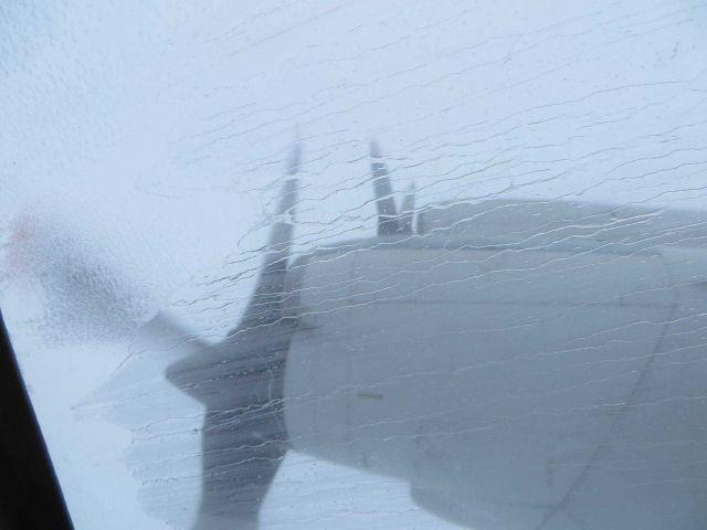Rain streaking the windows of NOAA P-3 flying into Hurricane Edouard. Picture