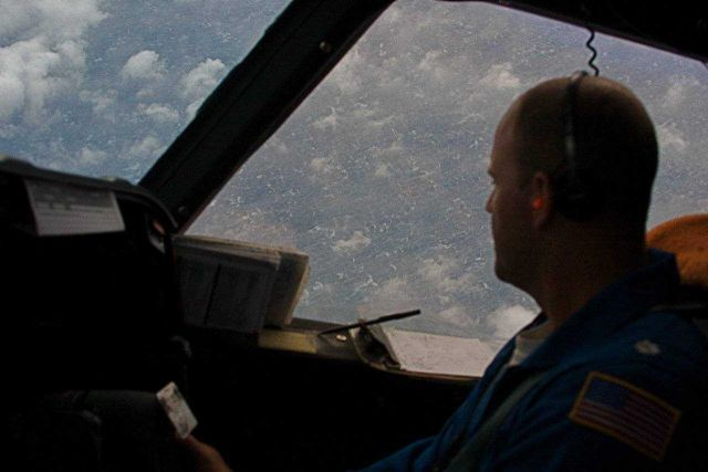 NOAA P-3 pilot looking down on the agitated sea surface of Hurricane Ike. Picture
