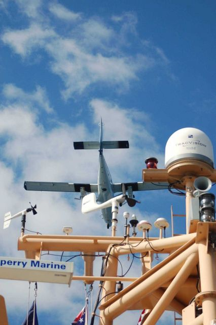 NOAA Twin Otter aircraft flying over NOAA Ship PISCES during Deep Water Horizon disaster. Picture