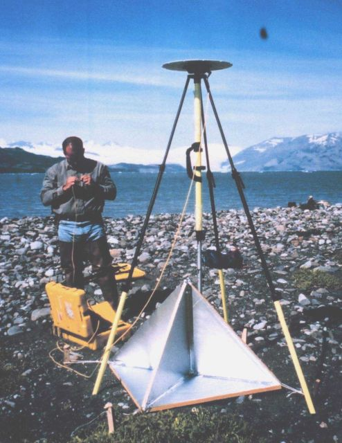 Mike Aslaksen setting up GPS antenna over radar reflector which was used for controlling airborne synthetic aperture radar survey. Picture