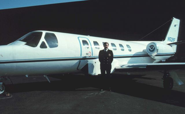 Pilot, Commander Bob McCann, standing by NOAA Cessna Citation II N52RF at Dulles International Airport. Picture
