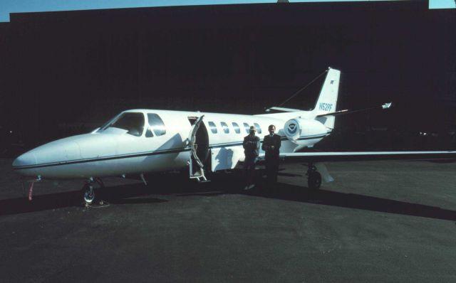Photogrammetrist Bill Hawken and Commander Bob McCann standing by NOAA Cessna Citation II N52RF at Dulles International Airport. Picture