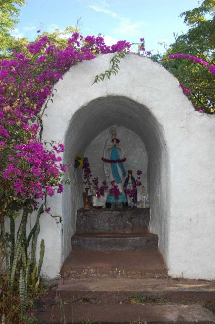A shrine draped with bougainvillea, reminiscent of California missions. Picture