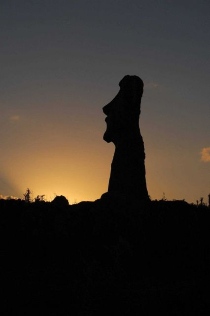 A moai silhouetted in one of the thousands of sunsets that have occurred since its being placed on the rocky shores of Easter Island. Picture