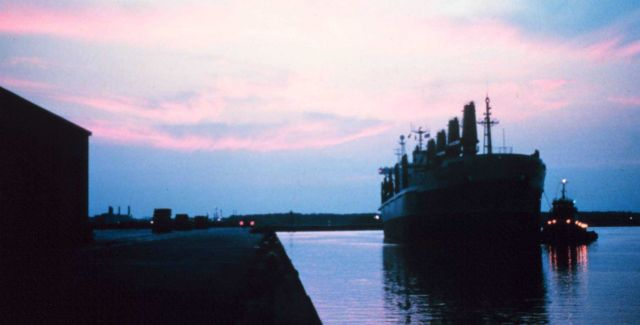 A large break-bulk merchant vessel docking at sunset at Lake Charles. Picture