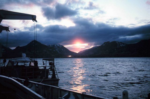 Survey launch on FAIRWEATHER at sunset while anchored in Wide Bay. Picture