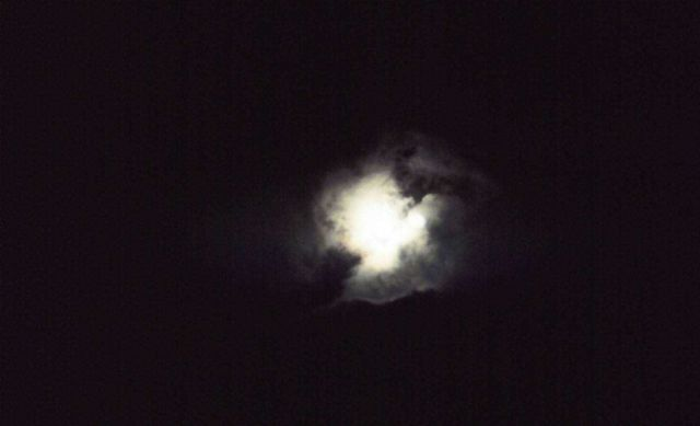 Moon through the clouds Picture