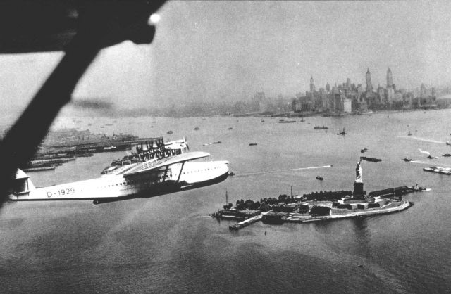 A flying boat on arrival at New York passing over the Statue of Liberty Picture