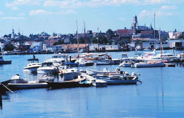 Yachts and workboats intermingling in Gloucester Harbor. Picture
