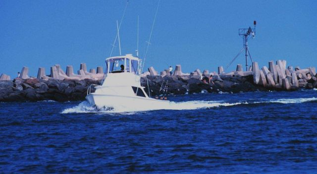 A recreational fishing boat passing the jetties at Manasquan Inlet Picture