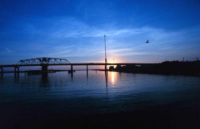 A sunset frames the Sullivan Island Bridge near Charleston. Picture