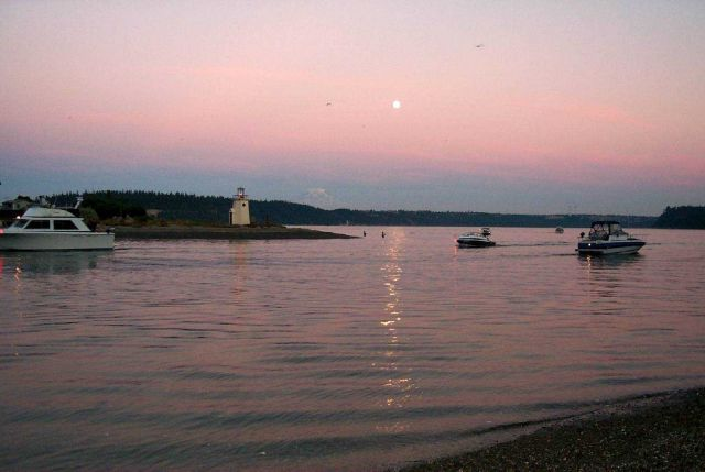 Moonrise over Gig Harbor as salmon fishermen try their luck in the shallows off the spit Picture