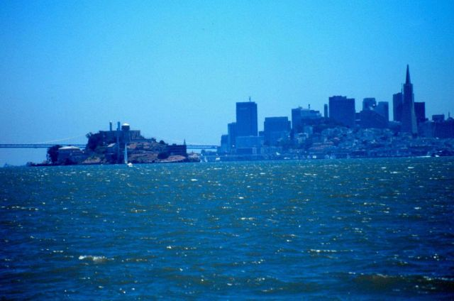 Alcatraz Island, the Oakland Bay Bridge, and the San Francisco skyline as seen from a small boat looking south. Picture