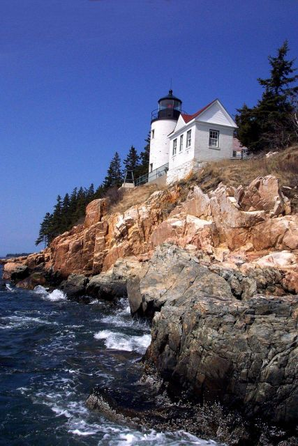 Bass Harbor Head Lighthouse from below and looking east at the shoreline. Picture