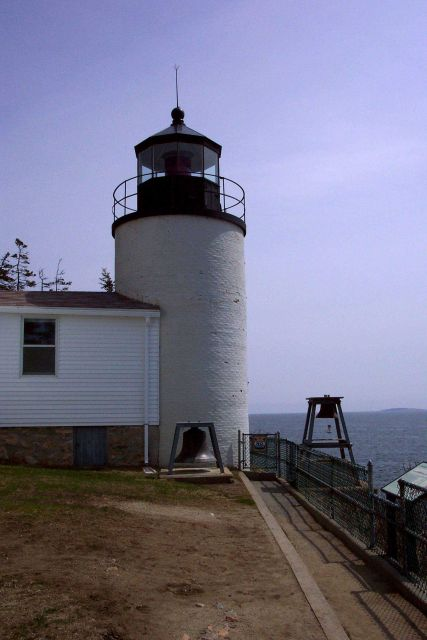 Bass Harbor Head Lighthouse with old fog bell as seen looking east from its west side. Picture