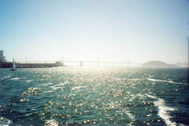 Looking down the bay towards the San Francisco - Oakland Bay Bridge on a hazy afternoon. Picture