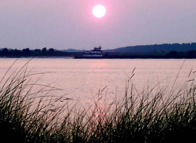 Ferry boat at sunset at the Cape Fear River entrance. Picture