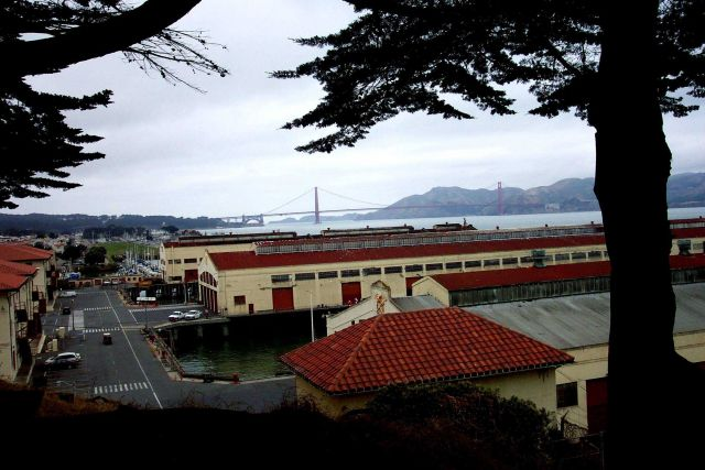 The Golden Gate Bridge as seen over the wharves at Fort Mason. Picture