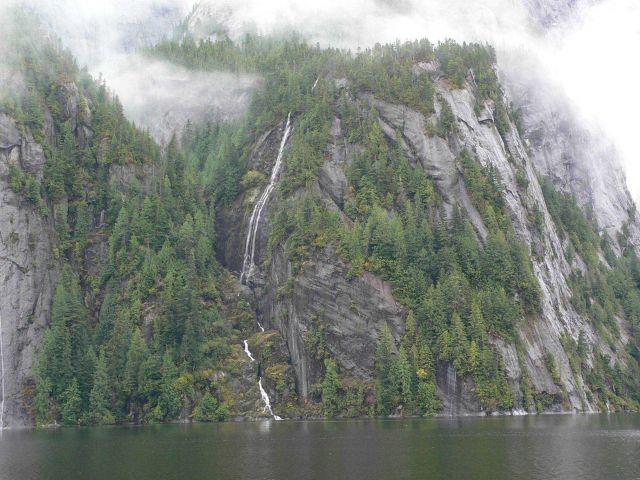 Misty mountains and waterfalls tumbling to the sea. Picture