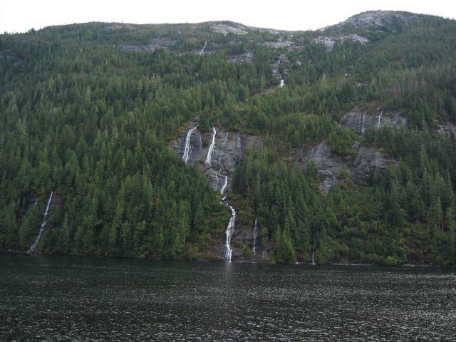 A whole school of waterfalls running to the sea. Picture