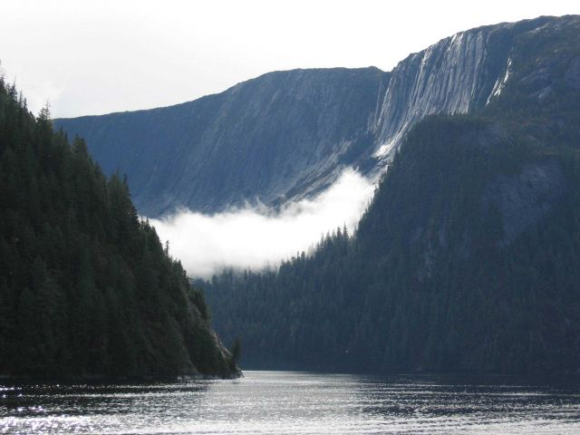 A ribbon of cloud draped across a glacial valley in the Rudyerd Bay area. Picture
