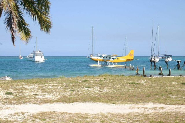 Seaplane taxiing with yachts anchored offshore at Fort Jefferson. Picture